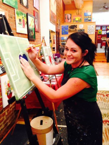 Artist Mandy Burge leads a class of soccer players at Merlot and a Masterpiece.