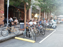 Turning underutilized space into bike parking, pedestrian zones, buffered bike lanes and/or parklets.