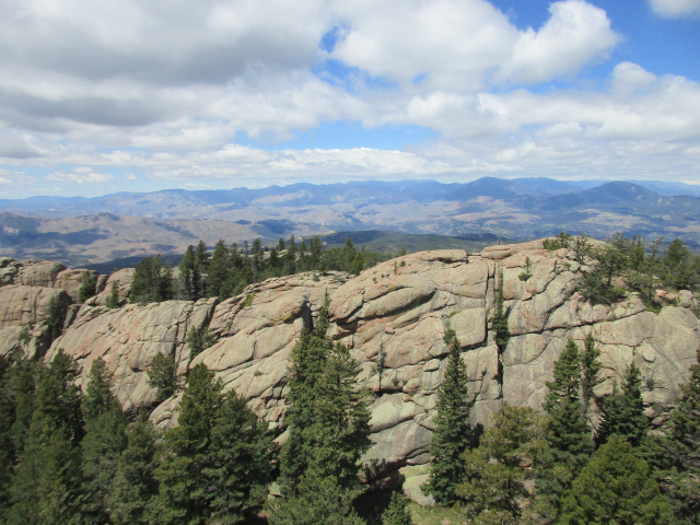 Views to the west from the lookout, looking towards the Hayman burn scar and Lost Creek Wilderness.  USFS photo, Summer 2019.