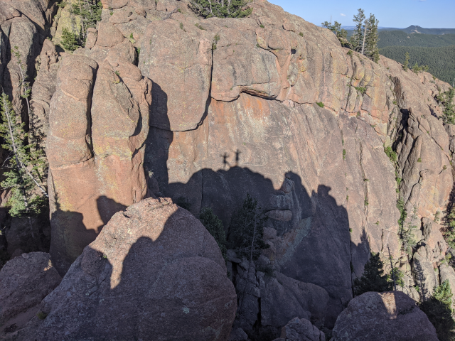 Me and my partner's silhouette against the rock after climbing the Monument formation. June 30th, Andy Eames.