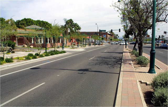 Sample Two: Does this image illustrate a street you would prefer a potential home buyer to take to get to your neighborhood?