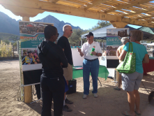 Your Voice volunteer Don Cox chatting with residents at the Oro Valley Farmers Market on 11/2/13