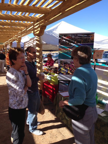 Your Voice volunteer Ellen Guyer talking about ideas at the Oro Valley Farmers Market on 11/9