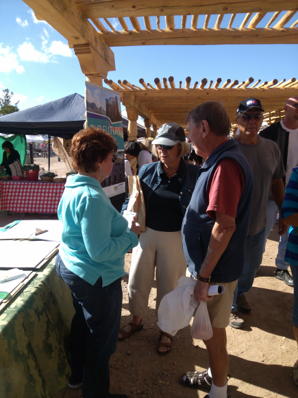 Your Voice volunteer Helen Dankwerth chatting with residents at the Farmers Market on 11/16/13