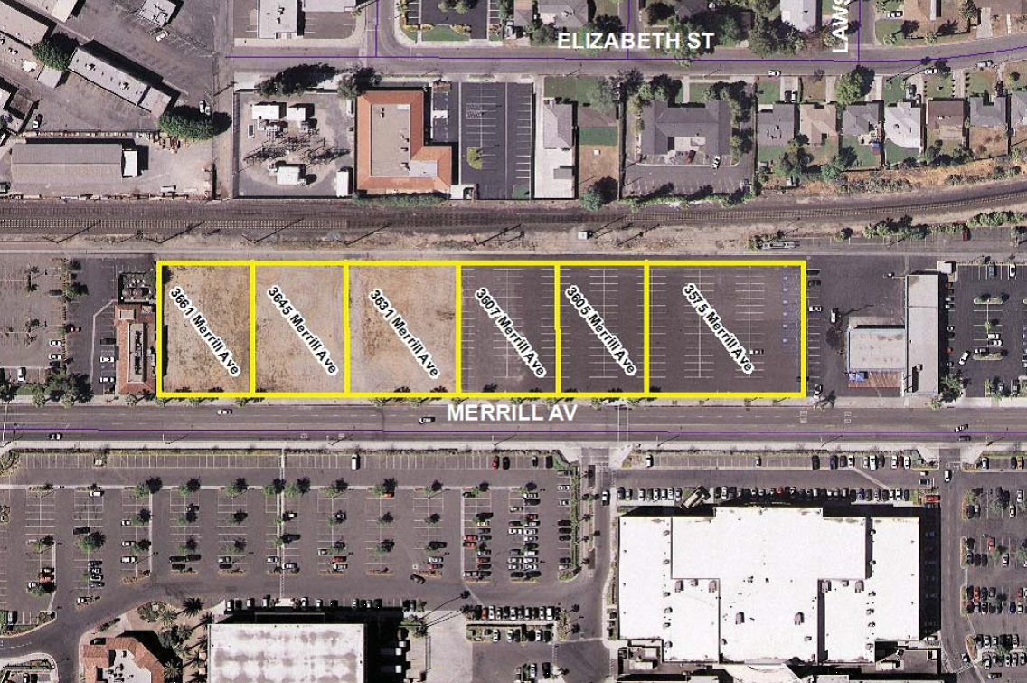 Mixed-use development with housing and retail proposed for Merrill Avenue across from Riverside Plaza
