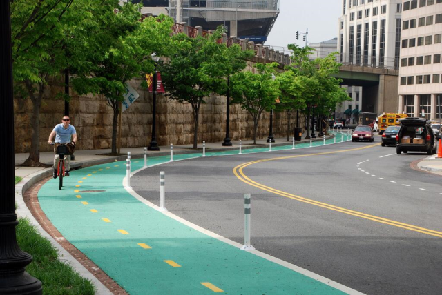 Protected bike lanes with visible demarcation between automobile traffic.