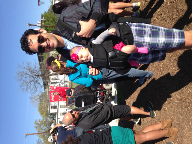 My husband and baby at the opening of labor street park, a revitalized park in our downtown neighborhood.
